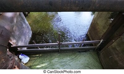 Industrial wastewater and foam - Foam in the channel of...