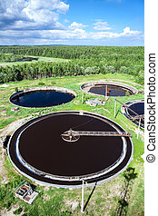 Industrial wastewater treatment plant in evergreen forest