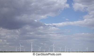 Industrial wind energy turbines the blue sky in thick white...