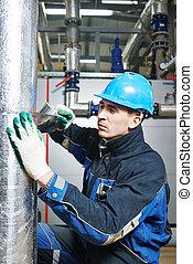 industrial worker at insulation work