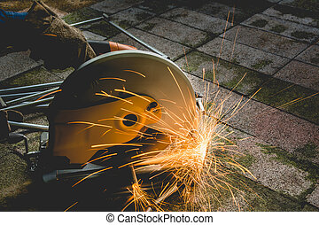 Industrial Worker at the factory steel cutting