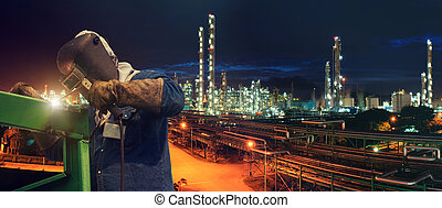 Industrial Worker at the factory welding