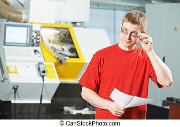 industrial worker portrait at tool workshop