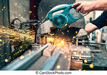 industrial worker using a compound mitre saw with circular ...