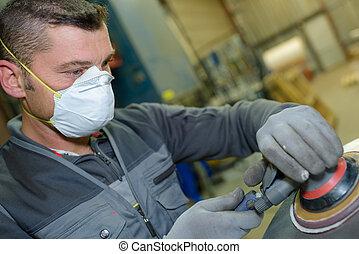 industrial worker wearing a mask