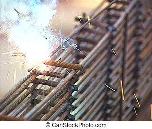 Industrial worker welding PAL