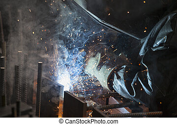 Industrial worker welding