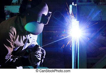 Industrial worker welding steel structure in factory, welding spa
