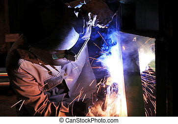 Industrial worker welding steel structure in factory, welding spa
