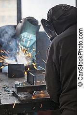 Industrial workers welding