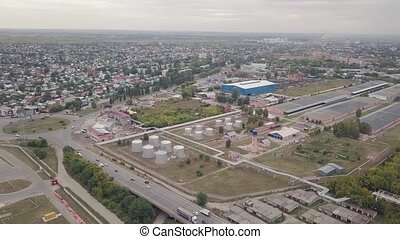 Industrial zone with chemical building, warehouse and railroad, aerial video in suburb town