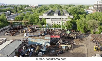 Industrial zone with working scrap metal crane aerial view