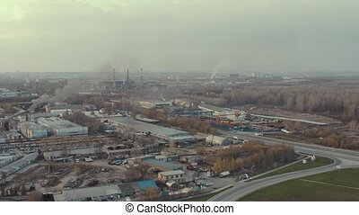 Industrial zone with workshop building, warehouse and production unit, aerial video in suburb area