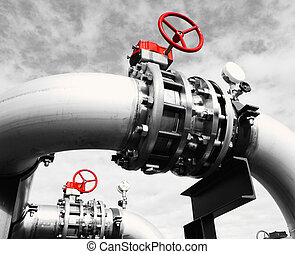 Industrial zone, Steel pipelines and valves against blue sky