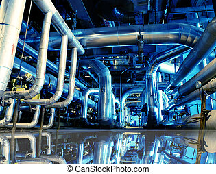 Industrial zone, Steel pipelines in blue tones with...