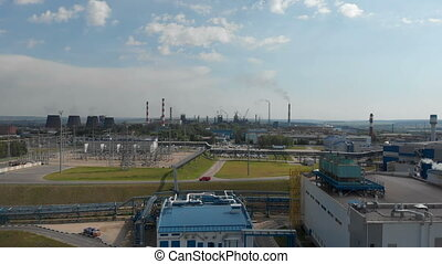 Industrial zone. White smoke is poured from the factory pipe...