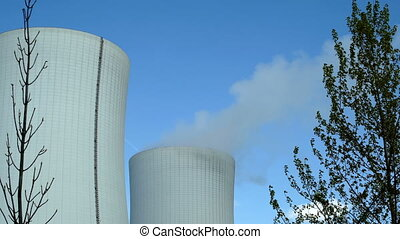 Industrical Cooling Towers Framed With Trees