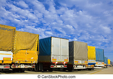 trucks - industry and commerce: trucks parked in a harbor