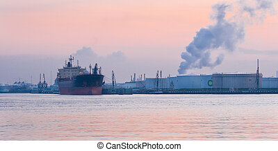 Industry and ship at sunset
