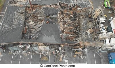 Industry building burnt down, destroyed by fire, Aerial. High quality 4k footage