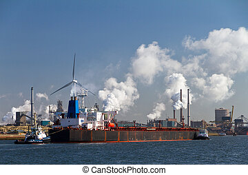 Industry cargo ship - Large cargo ship is brought in into...