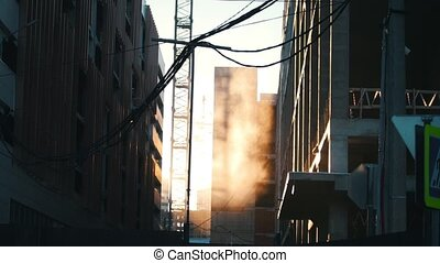 Industry construction and development. Dust soaring in the air, hanging wires