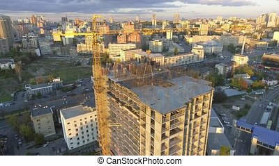 Industry construction and development. Workers building a new house.Aerial shot.The camera moves from the top down