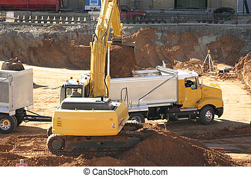 Industry in progress - Filling a dump truck with excavated...
