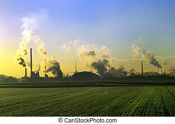 industry landscape in sunrise with smoking chimneys