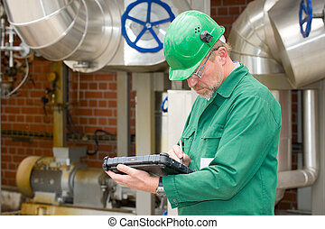 Industry - Middle ages industrial worker in front of some...