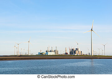 Industry near the coast - Industry and windmills at the...