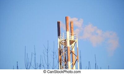 Industry pipes pollute the air with smoke
