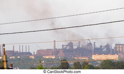 Industry Pipes Pollute the Atmosphere With Smoke