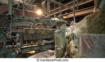 Industry. View of machine loads bricks on conveyor -...