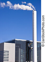 White industry chimney with white smoke with a blye sky