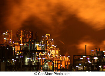 industry with fire and smoke at night