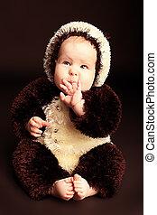 infancy - Beautiful baby in panda costume. Shot in a studio.