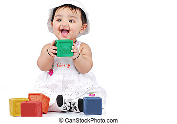 Infant 6-8 month - baby playing with colourful blocks