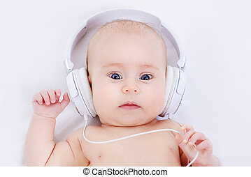 infant baby in headphones