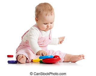 Infant baby plays with educational toy