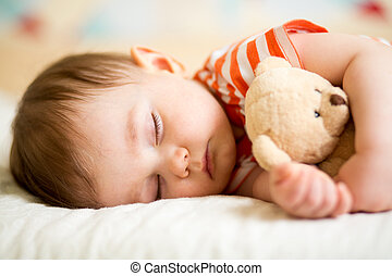 infant baby sleeping with plush toy