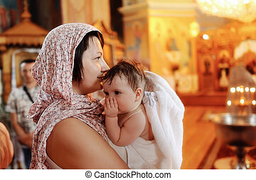 infant baptism - in the church against the icons and lights...