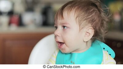 Infant boy wiping snot
