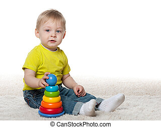 Infant boy with a toy
