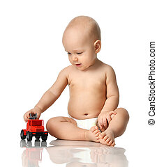Infant child baby boy toddler sitting in diaper playing with red car toy