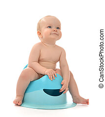 Infant child baby boy toddler sitting on toilet stool pot