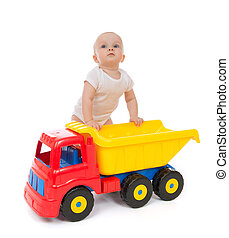 Infant child baby boy toddler with big toy car truck