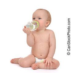 Infant child baby girl toddler sitting happy holding breastfeedi