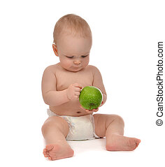 Infant child baby toddler sitting in diaper with green apple