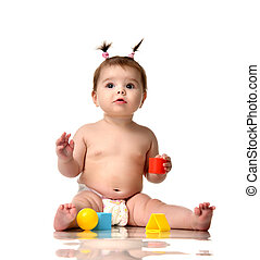 Infant child baby toddler sitting in diaper with red blue and yellow brick ball toys playing isolated on a white